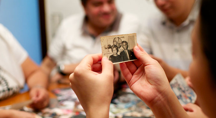 family looking at old photos