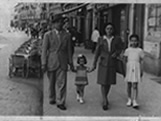 Italian Ancestors: An Italian family walks down the sidewalk together, 1950.