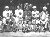 Italian Ancestors: A group of Italian nurses and orphaned children sit for a group photograph.