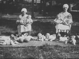 Italian Ancestors: Two Italian nurses during outdoor leisure time with orphaned infants.