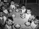 Italian Ancestors: Picture of young Italian children eating their lunch.