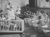 Italian Ancestors: Italian orphaned infants look on from their cribs and bassinets.