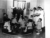 Italian Ancestors: Italian nurses and orphan children during playtime.