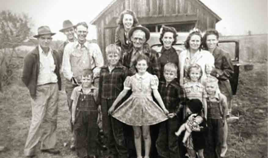 Large Family Posing in Front of Barn - Black and White Photo